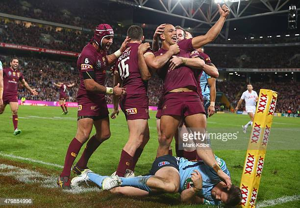Will Chambers of the Maroons celebrates with his team mates after scoring a try during game three of the State of Origin series between the...