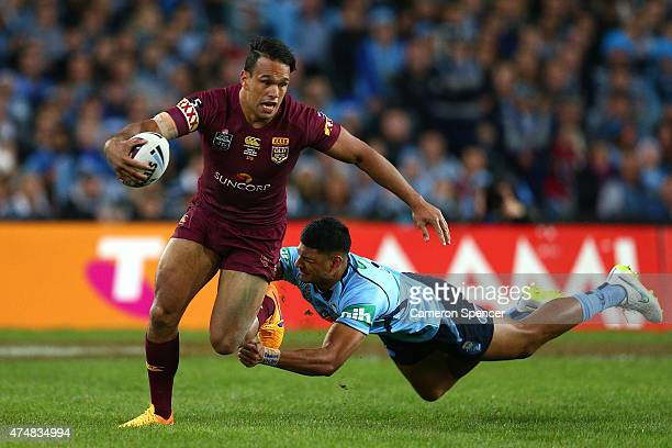 Will Chambers of the Maroons is tackled by Daniel Tupou of the Blues during game one of the State of Origin series between the New South Wales Blues...