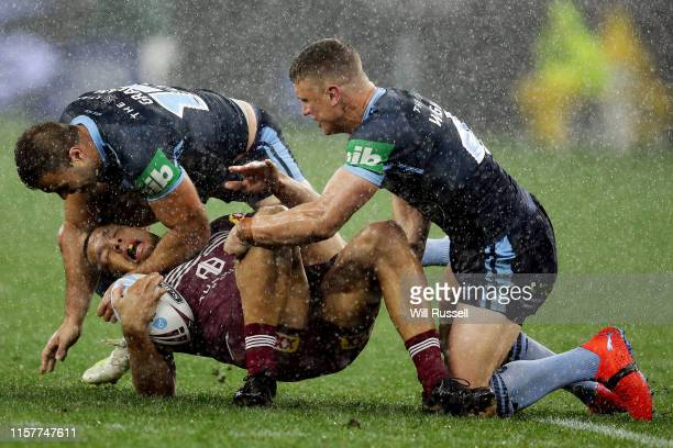 Will Chambers of the Maroons is tackled during game two of the 2019 State of Origin series between the New South Wales Blues and the Queensland...