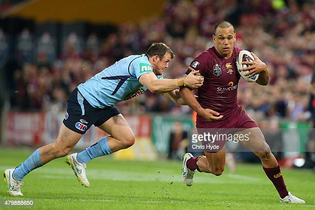 Will Chambers of the Maroons runs the ball during game three of the State of Origin series between the Queensland Maroons and the New South Wales...