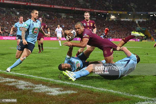 Will Chambers of the Maroons scores a try during game three of the State of Origin series between the Queensland Maroons and the New South Wales...