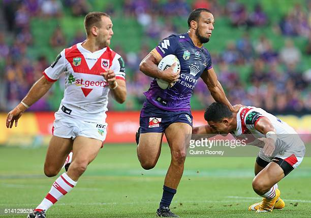 Will Chambers of the Storm breaks through a tackle during the round one NRL match between the Melbourne Storm and the St George Illawarra Dragons at...