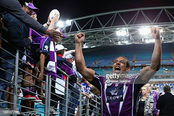 Will Chambers of the Storm celebrates as his walks down the players tunnel after winning the 2012 NRL Grand Final match between the Melbourne Storm...