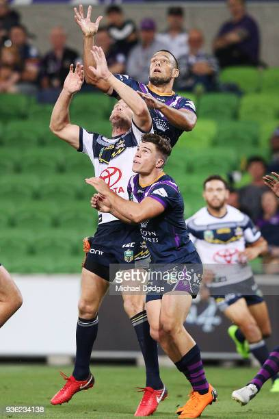 Will Chambers of the Storm compete for the ball over the top during the round three NRL match between the Melbourne Storm and the North Queensland...