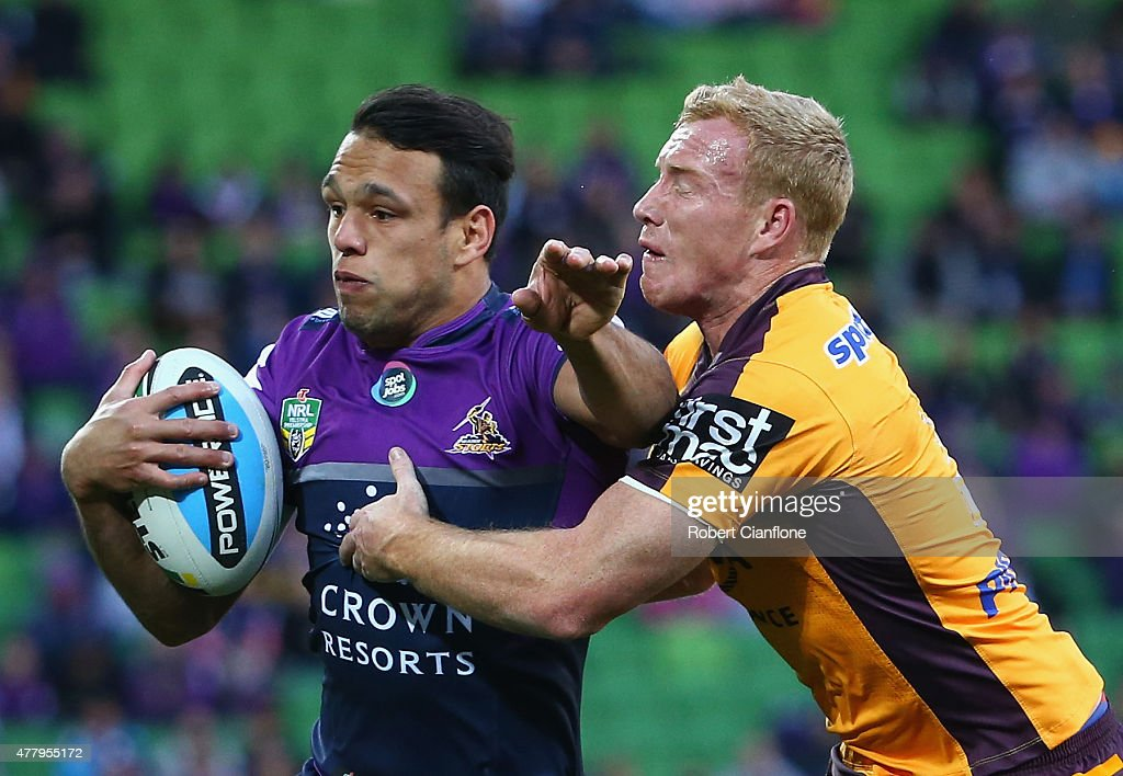 Will Chambers of the Storm is challenged by Jack Reed of the Broncos during the round 15 NRL match between the Melbourne Storm and the Brisbane Broncos at AAMI Park on June 21, 2015 in Melbourne, Australia.