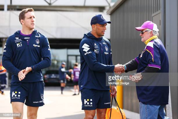 Will Chambers of the Storm is greeted by a fan during a Melbourne Storm NRL media opportunity at AAMI Park on September 24 2018 in Melbourne Australia