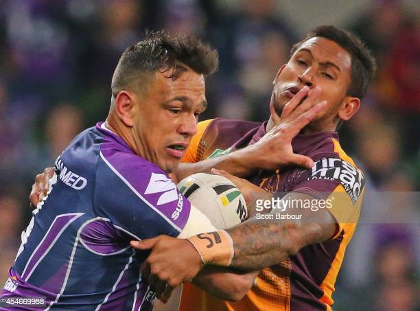 Will Chambers of the Storm is tackled by Ben Barba of the Broncos during the round 26 NRL match between the Melbourne Storm and the Brisbane Broncos...
