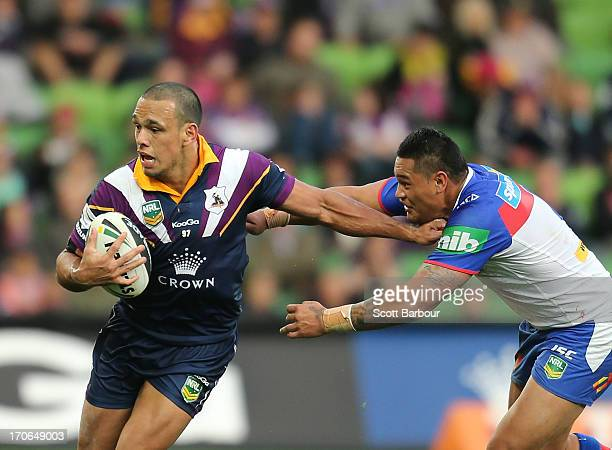 Will Chambers of the Storm is tackled by Joey Leilua of the Knights during the round 14 NRL match between the Melbourne Storm and the Newcastle...