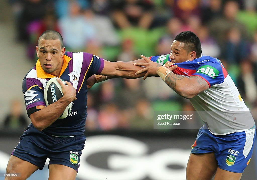 Will Chambers of the Storm is tackled by Joey Leilua of the Knights during the round 14 NRL match between the Melbourne Storm and the Newcastle Knights at AAMI Park on June 16, 2013 in Melbourne, Australia.