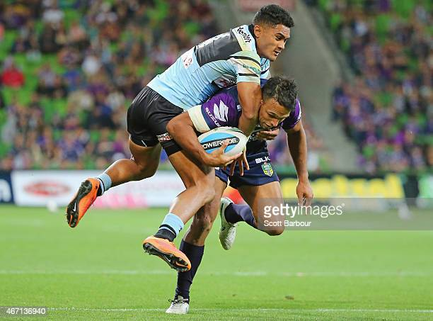 Will Chambers of the Storm is tackled by Ricky Leutele of the Sharks during the round three NRL match between the Melbourne Storm and the Cronulla...