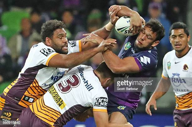 Will Chambers of the Storm is tackled by Tom Opacic of the Broncos during the round 25 NRL match between the Melbourne Storm and the Brisbane Broncos...