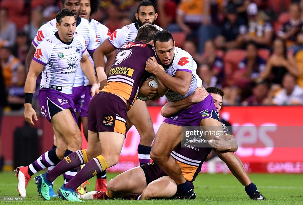 Will Chambers of the Storm is tackled during the round seven NRL match between the Brisbane Broncos and the Melbourne Storm at Suncorp Stadium on April 20, 2018 in Brisbane, Australia.