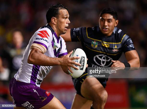 Will Chambers of the Storm looks to get past Jason Taumalolo of the Cowboys during the round 22 NRL match between the North Queensland Cowboys and...
