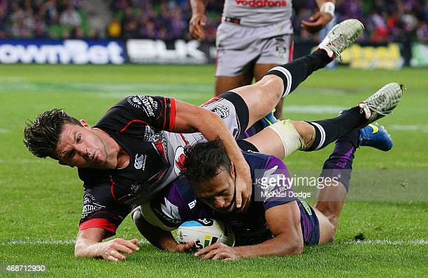 Will Chambers of the Storm scores a try against Chad Townsend of the Warriors during the round five NRL match between the Melbourne Storm and the New...