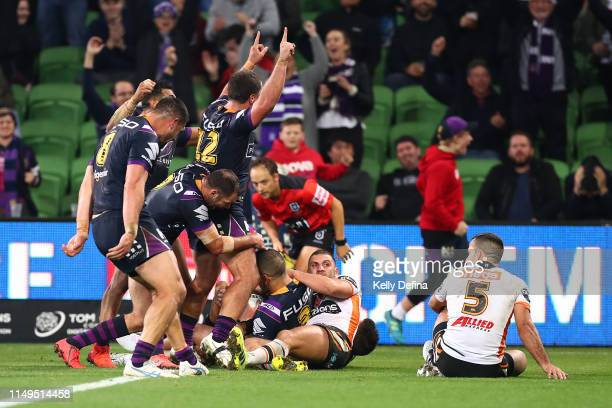 Will Chambers of the Storm scores a try during the round 10 NRL match between the Melbourne Storm and the Wests Tigers at AAMI Park on May 16 2019 in...