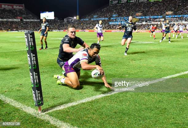 Will Chambers of the Storm scores a try during the round 22 NRL match between the North Queensland Cowboys and the Melbourne Storm at 1300SMILES...