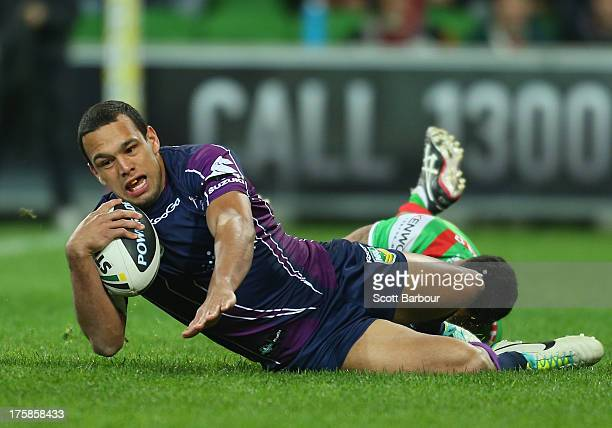 Will Chambers of the Storm scores the first try of the match during the round 22 NRL match between the Melbourne Storm and the South Sydney Rabbitohs...