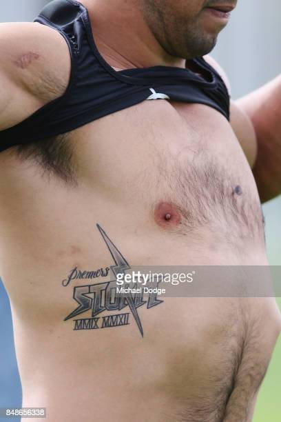Will Chambers of the Storm shows off a premiership tattoo during a Melbourne Storm NRL training session at AAMI Park on September 18 2017 in...