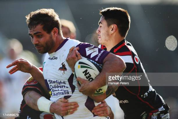 Will Chambers of the Storm tries to get past Shaun Johnson of the Warriors during the round 20 NRL match between the New Zealand Warriors and the...