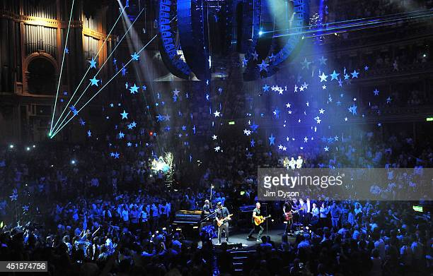 Will Champion Jonny Buckland Chris Martin and Guy Berryman of Coldplay perform live on stage at the Royal Albert Hall on July 1 2014 in London England