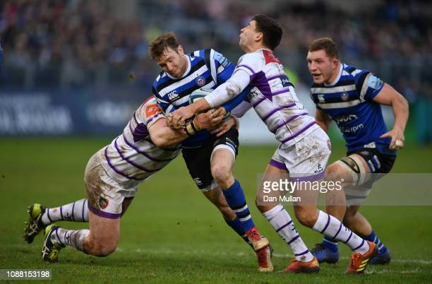 Will Chudley of Bath is tackled by Dan Cole and Ben Youngs of Leicester Tigers during the Gallagher Premiership Rugby match between Bath Rugby and...
