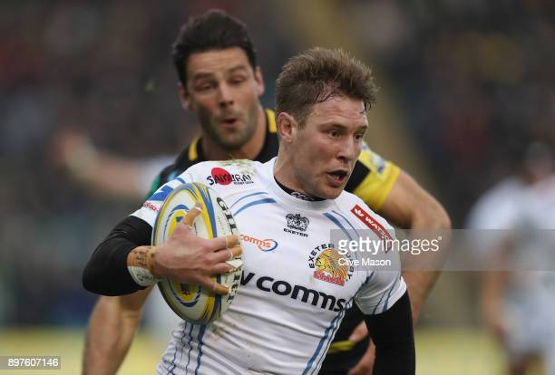 Will Chudley of Exeter Chiefs breaks through to score a try during the Aviva Premiership match between Northampton Saints and Exeter Chiefs at...