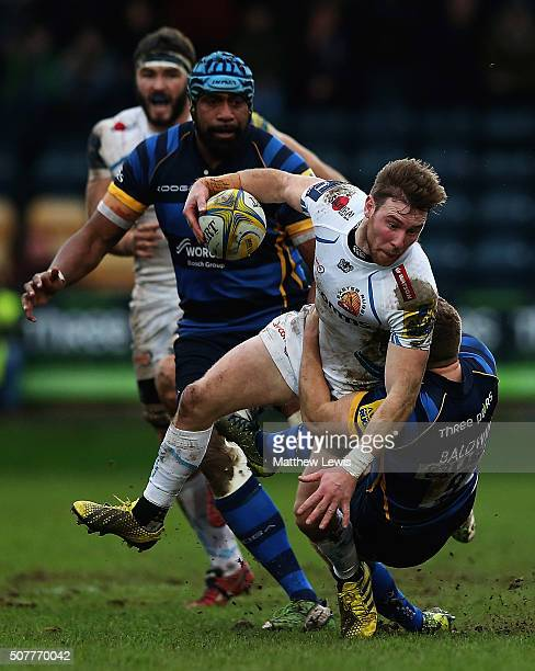 Will Chudley of Exeter Chiefs is tackled by Luke Baldwin of Worcester Warriors during the Aviva Premiership match between Worcester Warriors and...