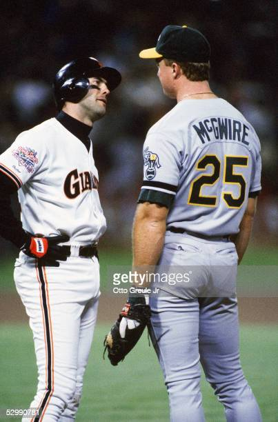 Will Clark of the San Francisco Giants has words with Mark McGwire of the Oakland Athletics during the 1989 World Series at Candlestick Park in...