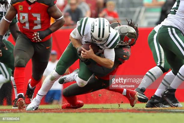 Will Clarke of the Bucs brings down Josh McCown of the Jets during the regular season game between the New York Jets and the Tampa Bay Buccaneers on...