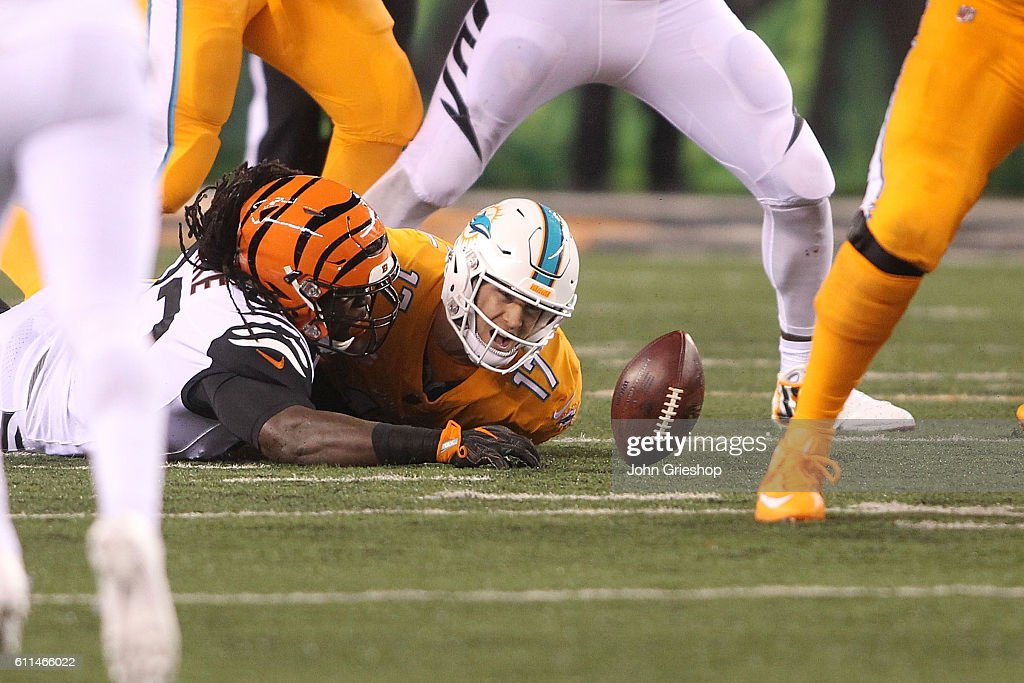 Will Clarke #93 of the Cincinnati Bengals tackles Ryan Tannehill #17 of the Miami Dolphins and causes a fumble during the second quarter at Paul Brown Stadium on September 29, 2016 in Cincinnati, Ohio.