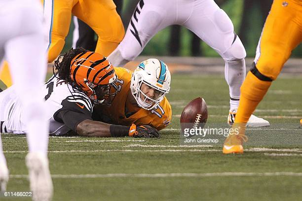 Will Clarke of the Cincinnati Bengals tackles Ryan Tannehill of the Miami Dolphins and causes a fumble during the second quarter at Paul Brown...