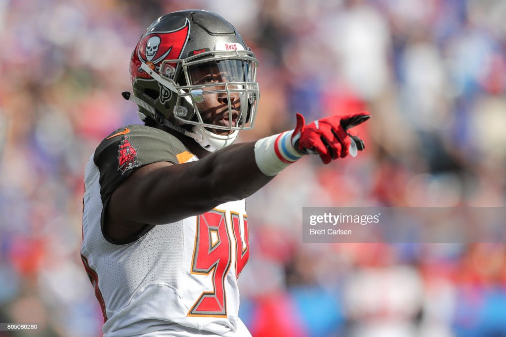 Will Clarke #94 of the Tampa Bay Buccaneers points during an NFL game against the Buffalo Bills on October 22, 2017 at New Era Field in Orchard Park, New York.