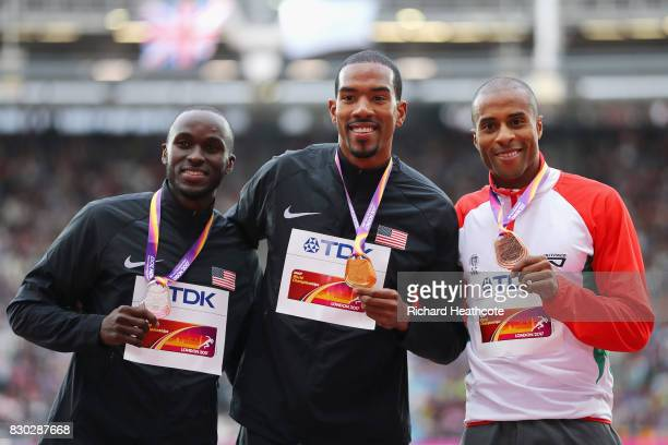 Will Claye of the United States silver Christian Taylor of the United States gold and Nelson Evora of Portugal bronze pose with their medals for the...
