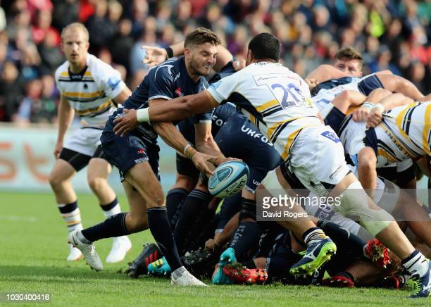 Will Cliff of Sale Sharks passes the ball as Alafoti Faosiliva tackles during the Gallagher Premiership Rugby match between Sale Sharks and Worcester...