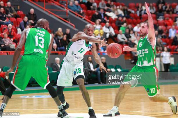 Will Clyburn of Darussafaka Dogus in action against Joaquin Colom end Stephane Lasme of UNICS Kazan during the EuroCup basketball match between UNICS...