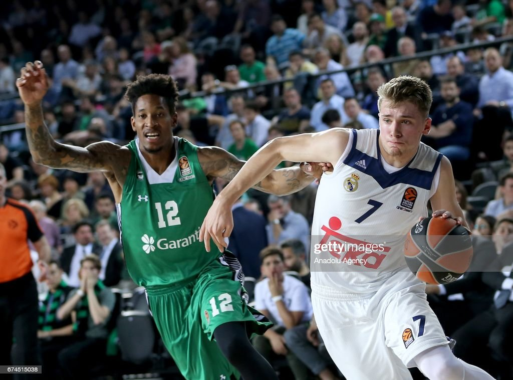 Will Clyburn (12) of Darussafaka Dogus in action against Luka Doncic (7) of Real Madrid during the Turkish Airlines EuroLeague Playoffs Game 4 between Darussafaka Dogus and Real Madrid at Volkswagen Arena in Istanbul, Turkey on April 28, 2017.