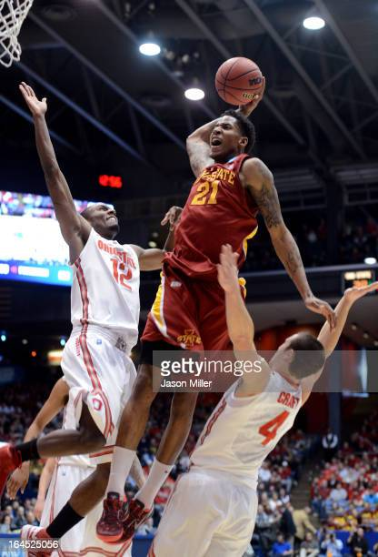 Will Clyburn of the Iowa State Cyclones drives to the basket against Sam Thompson and Aaron Craft of the Ohio State Buckeyes in the first half during...