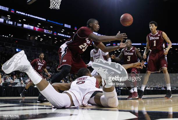 Will Cummings of the Temple Owls and Cady Lalanne of the Massachusetts Minutemen scramble for the loose ball during the Quarterfinals of the Atlantic...