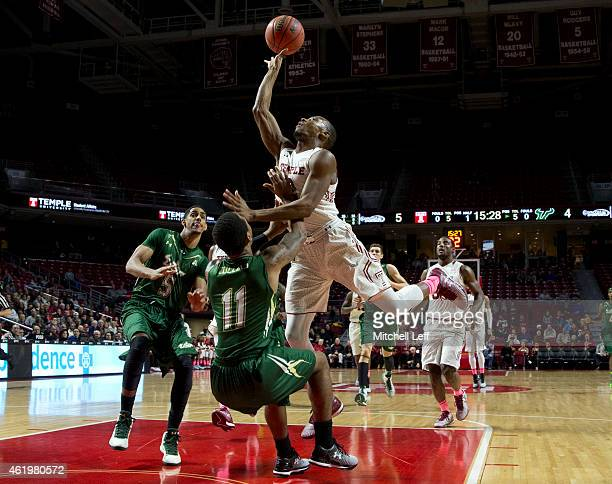 Will Cummings of the Temple Owls attempts a layup and is fouled by Anthony Collins of the USF Bulls on January 22 2015 at the Liacouras Center in...