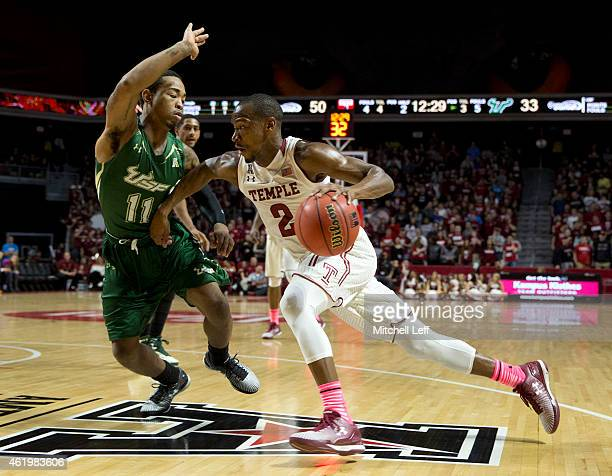 Will Cummings of the Temple Owls drives to the basket with Anthony Collins of the USF Bulls defending on the play on January 22 2015 at the Liacouras...