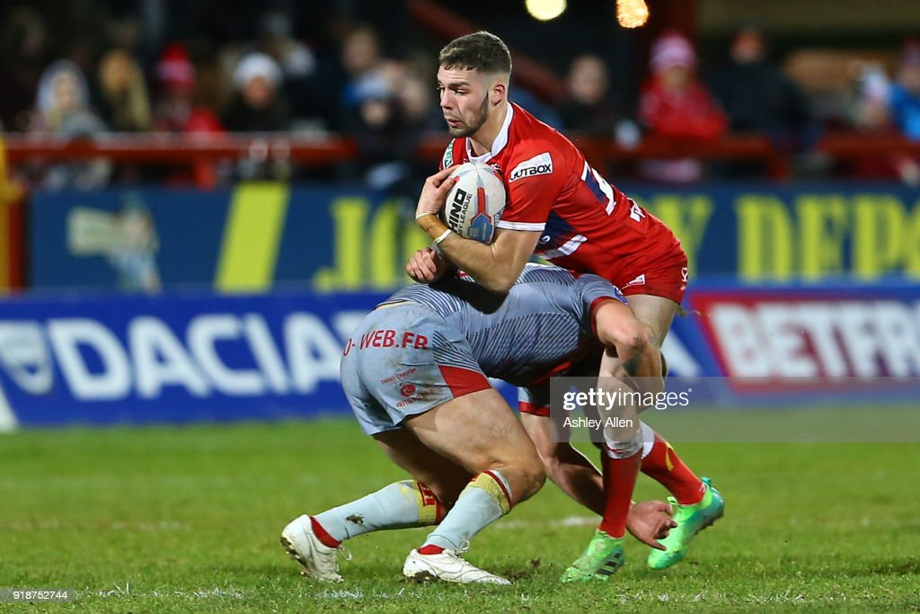 Will Dagger (R) of Hull KR is tackled by Alrix Da Costa (L) of the Catalans Dragons during the BetFred Super League match between Hull KR and Catalans Dragons at KCOM Craven Park on February 15, 2018 in Hull, England.