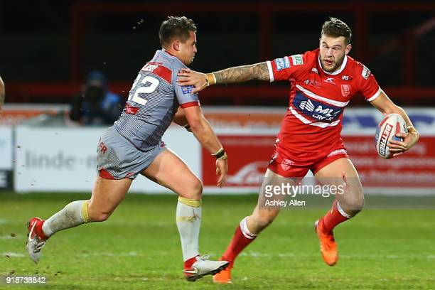 Will Dagger of Hull KR runs past Lucas Albert of the Catalans Dragons during the BetFred Super League match between Hull KR and Catalans Dragons at...