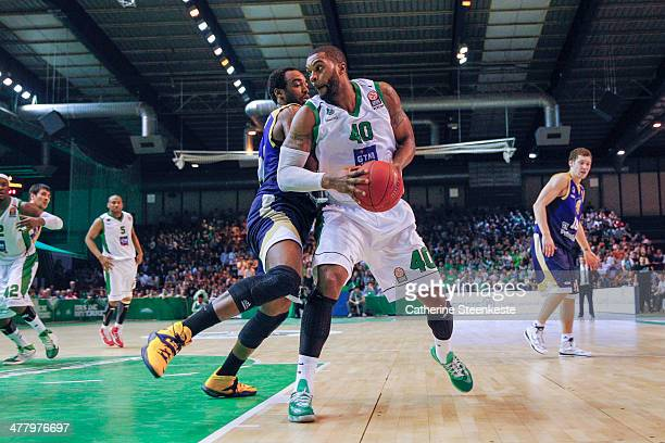Will Daniels of Nanterre is trying to go to the basket against Dajuan Summers of Budivelnik Kiev during the game between JSF Nanterre and Budivelnik...