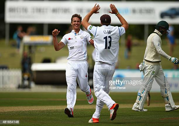 Will Davis of Derbyshire celebrates after taking the wicket of Michael Clarke of Australia during day one of the Tour Match between Derbyshire and...