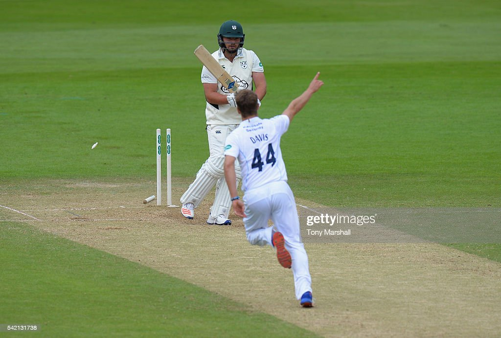 Will Davis of Derbyshire celebrates bowling out Joe Leach of Worcestershire during the Specsavers County Championship: Division Two match between Derbyshire and Worcestershire at The 3aaa County Ground on June 22, 2016 in Derby, England.