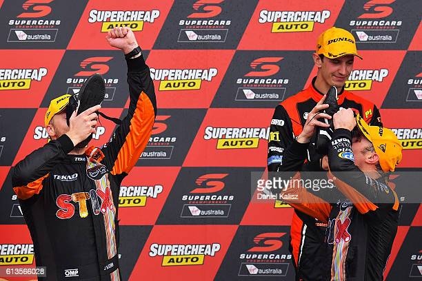 Will Davison and Jonothan Webb drivers of the Tekno Autosports Holden Commodore VF celebrate on the podium after winning the Bathurst 1000 which is...