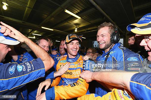 Will Davison driver of the Tradingpost FPR Ford celebrates with his teammates after taking pole position in the Top 10 shootout for the Bathurst 1000...