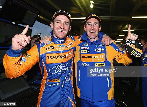 Will Davison driver of the Tradingpost FPR Ford celebrates with codriver John McIntyre after taking pole position in the Top 10 shootout for the...