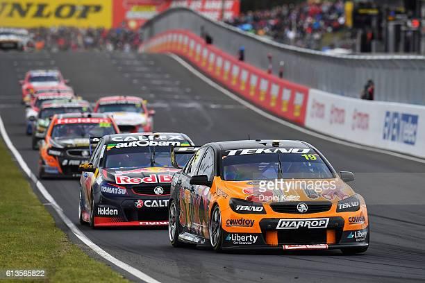 Will Davison drives the Tekno Autosports Holden Commodore VF leads Shane Van Gisbergen drives the Red Bull Racing Australia Holden Commodore VF...