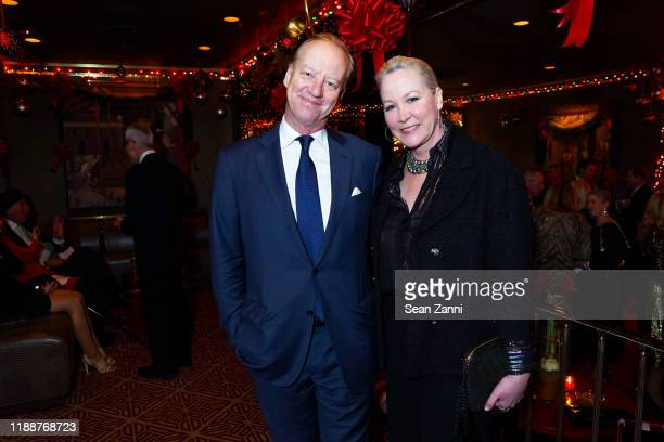 Will Denton and Sara Dodd attend Anne Hearst McInerney, Jay McInerney And George Farias Host Christmas Cheer at Doubles Club on December 13, 2019 in...
